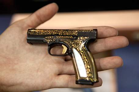 The Caracal F pistol is 95 mm long and has gold inlaid in steel.
